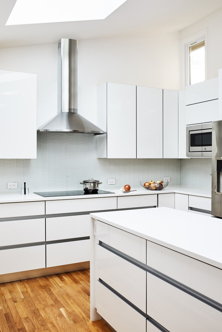 kitchen with wood flooring and stainless steel island mount range