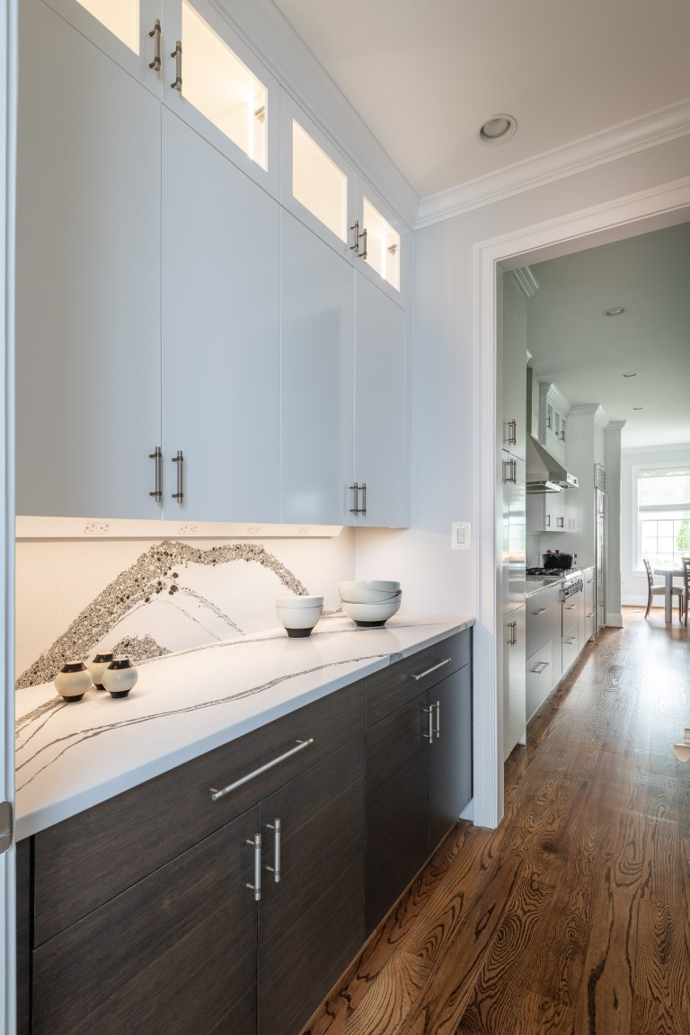 hard wood floors with brown bottom cabinets and white top pull handles cabinets with glass opening