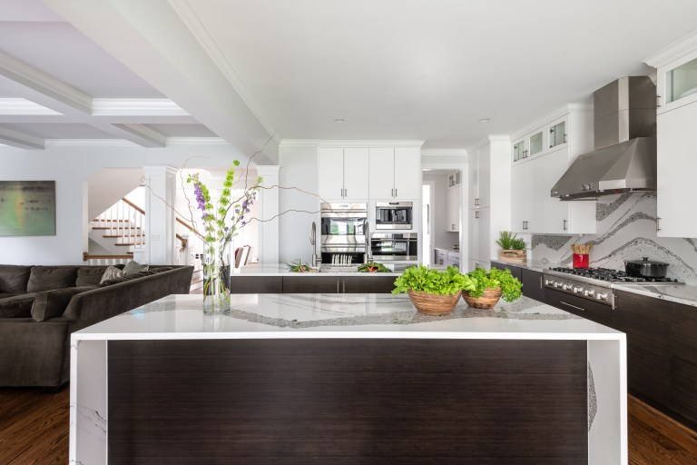 Brown and white kitchen island with matching cabinets