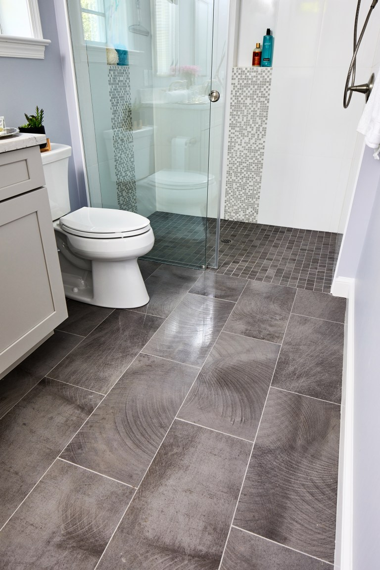 brick pattern tile flooring bathroom with walk in shower