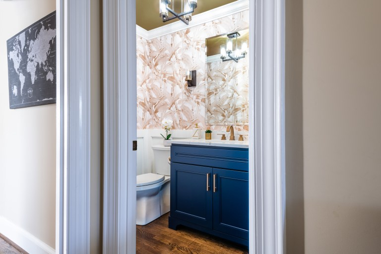 Case design remodeling transitional Maryland bathroom with hard wood flooring, gold ceiling, white floor standing one-piece toilet