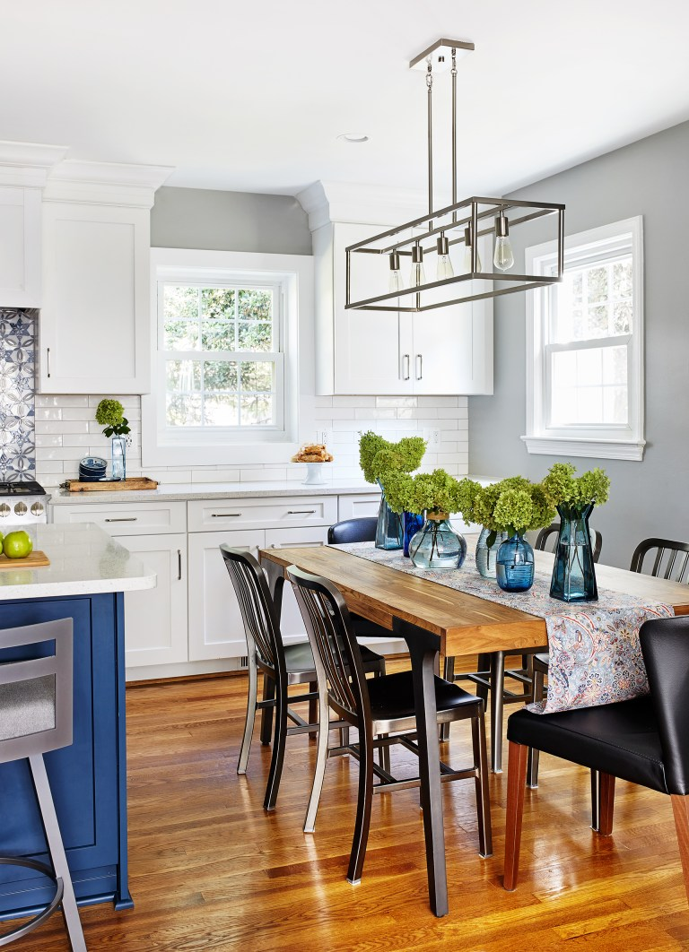 white cabinets and hard wood flooring, 5 light kitchen linear pendant above wooding table
