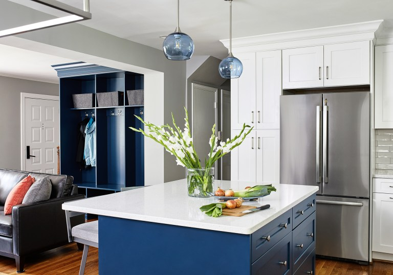 kitchen and living room opening with dark blue closet without doors matching kitchen island