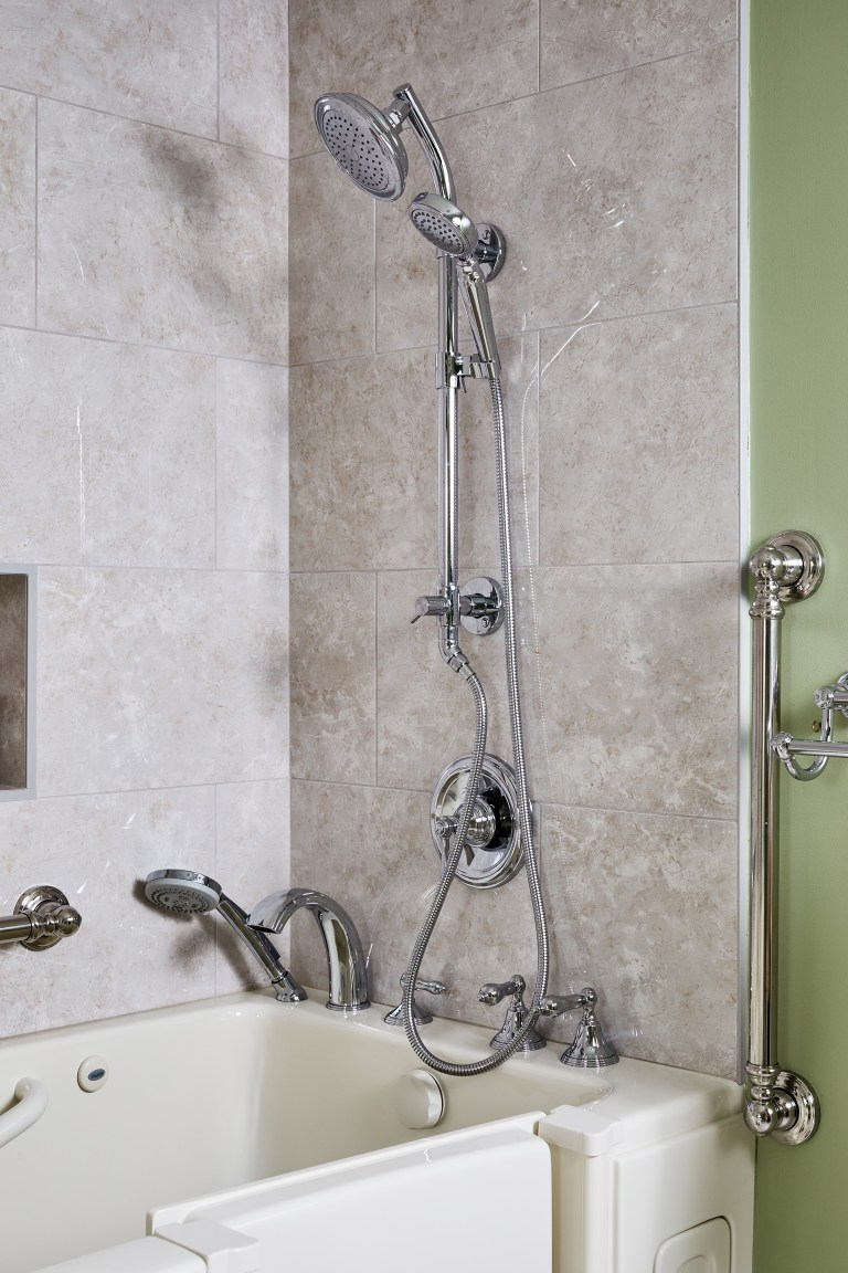 two–in–one stainless steel finish shower system with dual control handle, 3 setting diverter, showerhead, and hand shower with grab bar