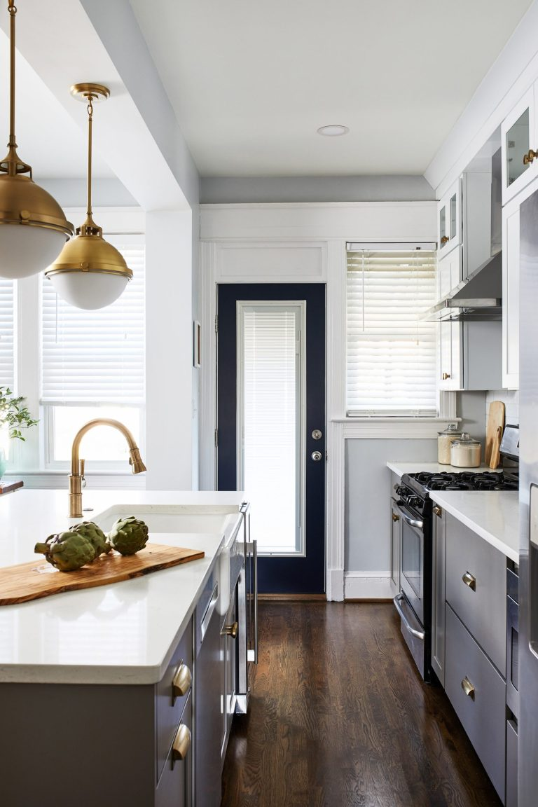 transitional white and grey dc kitchen remodeling with wood floors with pull out kitchen cabinets with gold pull handles