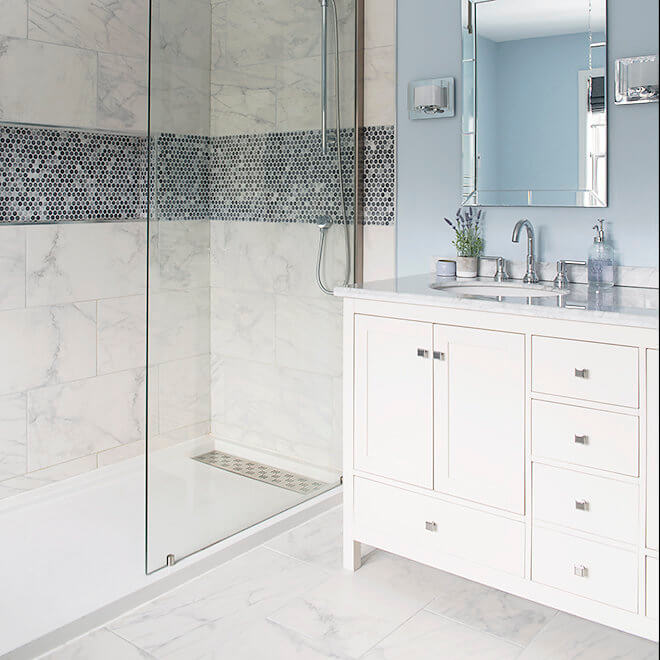 bathroom with marble tile fireplace tv soaker tub