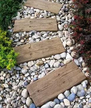 amenajarea gradinii cu pietris Pebble garden decoration ideas 20