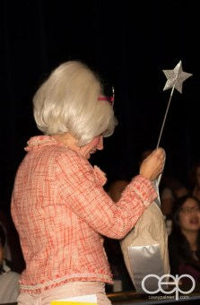 The Fairy Godmother (Barb Scheffler) placing some items into evidence.