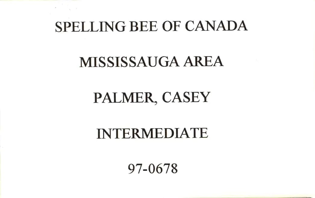 My badge from the 1996 Spelling Bee of Canada, reading: SPELLING BEE OF CANADA; MISSISSAUGA AREA; PALMER, CASEY; INTERMEDIATE; 97-0678