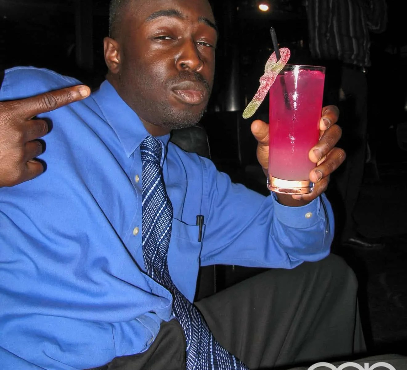 Me posing with a fruity drink