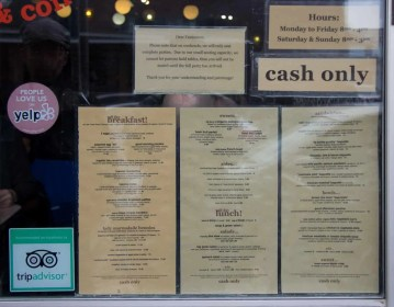 The menus posted inside the window of Lady Marmalade in Toronto, ON