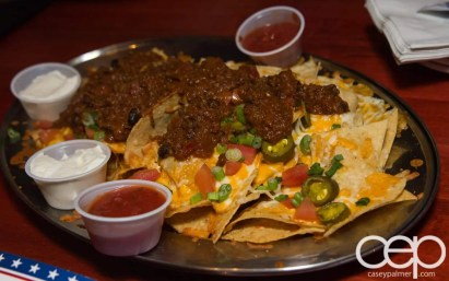 Team Trolling — All-Star Wings and Ribs — All Star Nachos — Freshly prepared Naho Chips topped with a 1/2 lb. of cheese, diced tomato, jalapenos, and shallots. Served with salsa and sour cream.