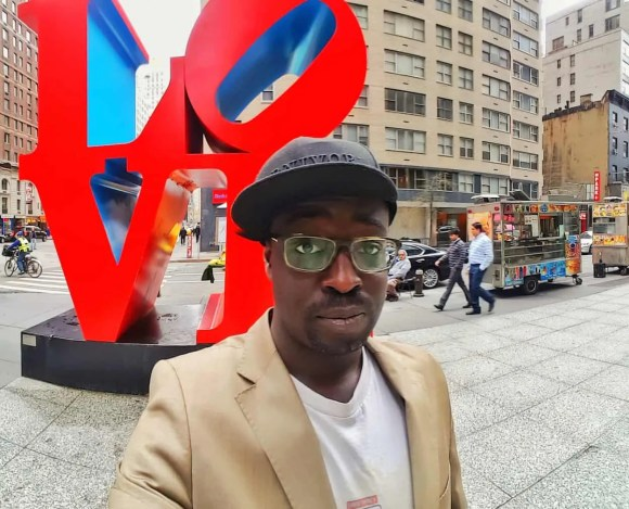 Casey Palmer x Swiffer Present—36 Hours in NYC—Casey Palmer and the NYC Love Sculpture at 6th Avenue and W 55th St