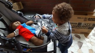 The Week That Was... October 4-10, 2015—Little Man Putting Tony the Cabbage Patch Kid Away in His Uppababy Vista Stroller
