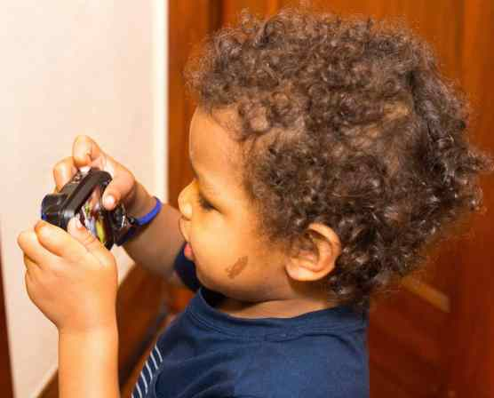 Making Memories Aplenty with the FujiFilm FinePix XP120! — My Preschooler Checking His Photos