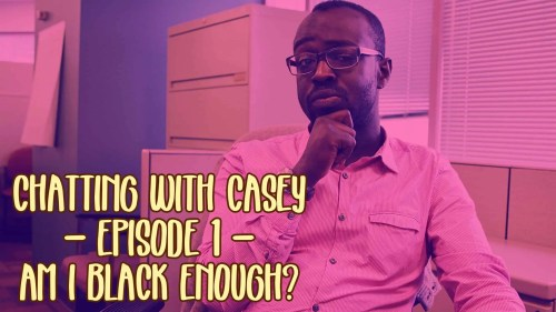 """A photo of Casey Palmer in an office chair with the text """"Chatting with Casey — Episode 1 — Am I Black Enough?"""" overlaid."""