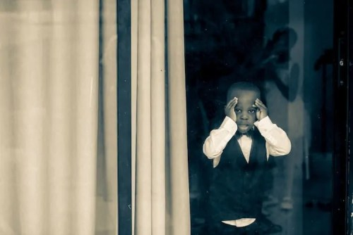 Live from the 3.5, 2020 2 — Do We Even NEED a Black History Month — Black Child in a Suit Looking Out a Window
