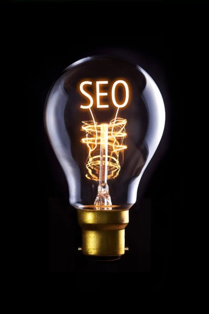 """SEO is a great idea: A light bulb on a dark background, and the filaments of the light bulb are curved into the acronym """"SEO""""."""