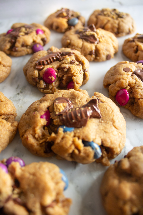 Close up of a batch of chocolate peanut butter cup cookies.