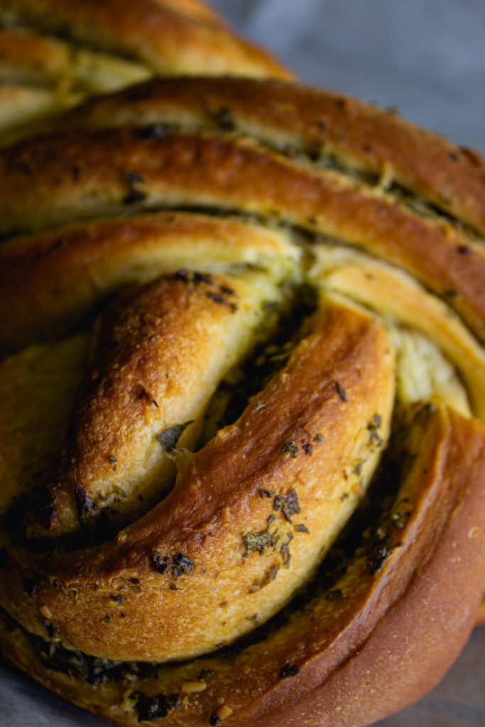 Close up of garlic herb twist bread.