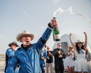106930767 1629414258625 Blue Origin First Human Flight L0 Jeff Bezos Celebration scaled