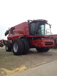 The new 2014 CIH 8230 combine on its delivery day.  It'll never be cleaner or more shiny than this day!