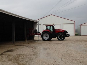 Ross has the corn planter parked inside, but it still remains 'hooked up', ready to go.