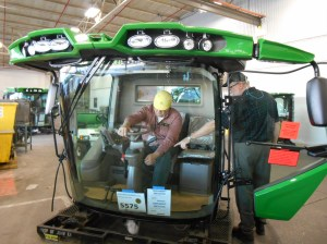Here, I'm being shown some features of the new cab.  You may notice at the bottom of the front glass, it is labeled with our farm name.  This is the exact cab that will be installed on our combine, probably as the first shift starts work late Sunday night.