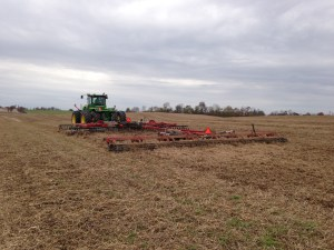 Larry is disking and rolling at the Roberson farm.