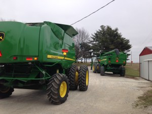 As the new S680 sits by the fuel building, Gene drives past with the 9770 on his way to deliver it to its new owners.  Out with the old... in with the new...