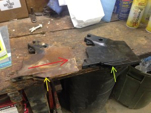Here are the old and new 'scrapers' side-by-side on the work bench.  The red arrow shows the direction of travel as the machine works in the field.  The yellow arrow points to the worn area.  Compare it to where the green arrow is pointing...no doubt that these things needed to be replaced.