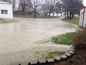 Here on Wednesday, you see the rain coming down, and streams of water running off the farm lot. Puddles everywhere!