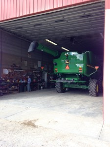 The new S680 combine rests in the shop, as we load the toolbox with tools, and John installs the 2-way FM radio.