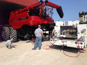 """Brad is here from JL Farm Equipment to reset the spacing on the back axle of the CIH 8230 combine.   It will """"track"""" better now when we harvest corn."""