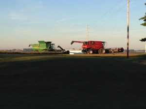 The combines sit quietly, waiting to roar into action later this morning.