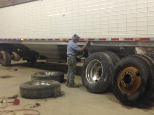 Brandon is polishing the aluminum.  He has the steel wheels removed.  Note the rusty one on the right... do you think it needs some paint?