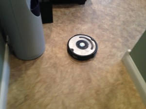 The little Roomba is darting around, sweeping the floor.  It'll help keep the place clean until Haley does her weekly mopping.  This office is a hard place to keep clean, but we make an effort to keep it presentable for the many small meetings that occur here.