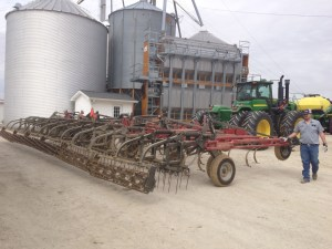 The field cultivator takes its turn in front to the shop.  Tire pressures will be corrected, and lubrication will occur.  The sweeps will be inspected, and the too-worn ones will be replaced.