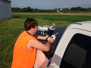 John prepares the UAV for flight over Burke.