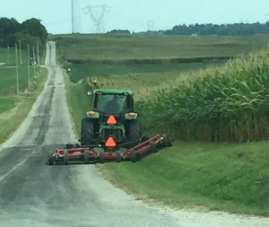 Here I go, along East Wheatland Road, trimming the roadside and highlighting the beautiful corn field.