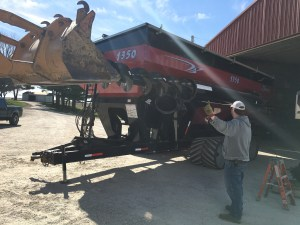 The upper auger was carried to position by the forklift, but carefully pushed into the tube with the backhoe