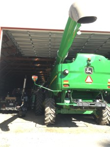 After getting a truck, a header, and the backhoe out of the way, we moved the combine near the door to give Kyle access to the cab.
