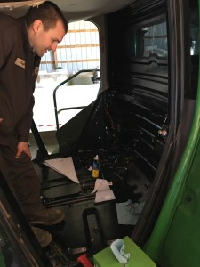 Here, Kyle shows that he has the cab down to the bare walls, ready to apply the new soundproofing panels