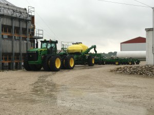 The 9330 and air drill wait for a drier time to get back to work.