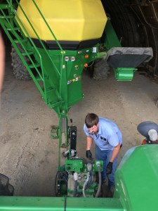 John happened to be spraying at the upper hilly part of the Huey farm, and he stopped to assist me to unhook the drill