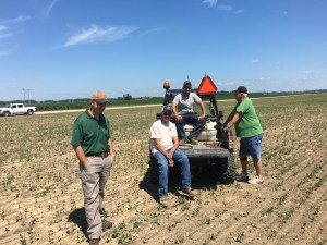 L-R: Troy Clawson, Monsanto rep, Ross, Brandon, and Bill Berry. We all agreed that we were seeing a sufficient number of soybeans!