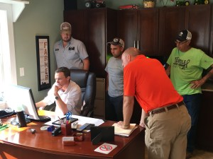 Along with Monsanto specialist Troy Clawson, (orange shirt) we observe as Angus shows us his Australian farm on Google Earth.