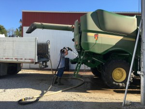 The Honda pump of the water trailer (what we use to supply the sprayer) makes quick work of washing down the under-the-skin surfaces of the combine