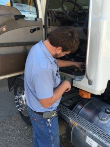 John routes the heavy wires up through the Vision's floor to a disconnect, then on to a special plug-in that will provide battery power to the new devices on the trailer