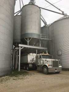 John runs the truck while Brandon operates the loading valve in the overhead bin.